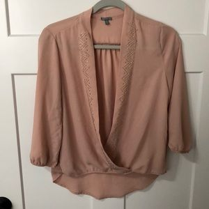 Size small deep plunge top.
